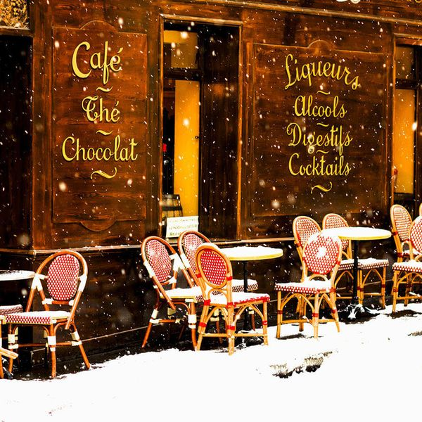 tables and chairs outside of cafe in london covered with snow