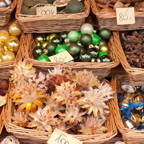 collection of christmas ornaments and trinkets in woven baskets