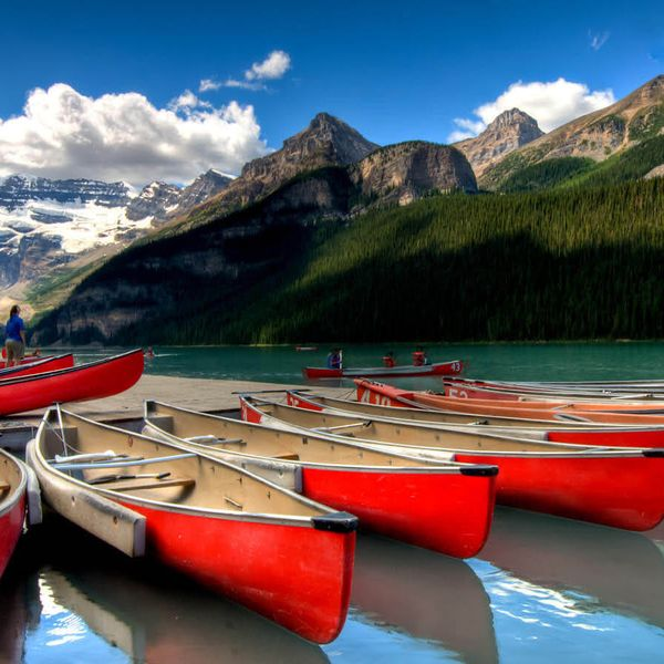 group of red canoes docked at lake in banff national park