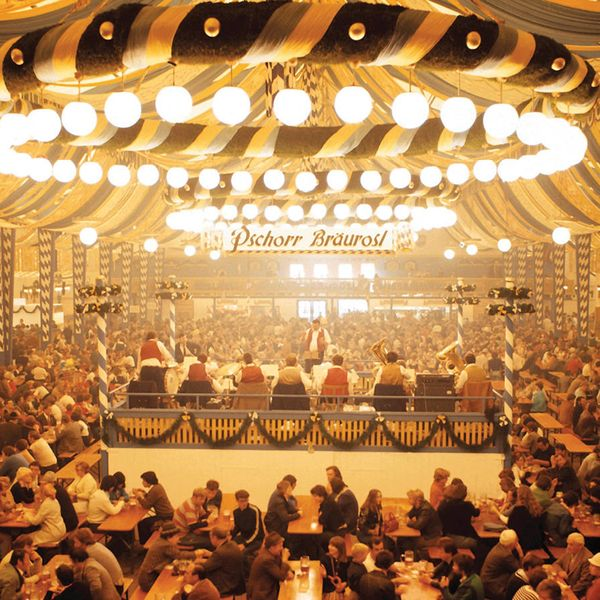 people drinking in german beer tent at oktoberfest in munich
