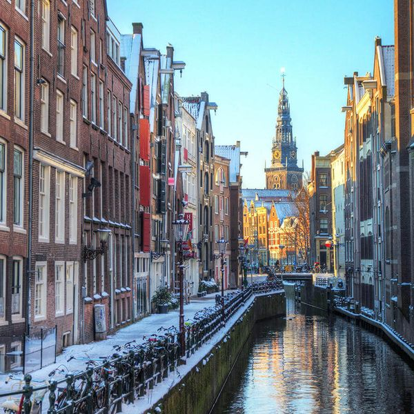 snowy canal in amsterdam
