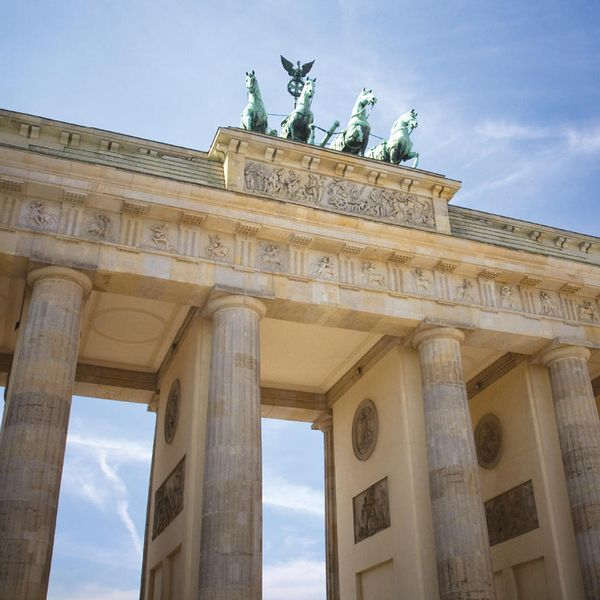 looking up at brandenburg gate in berlin germany