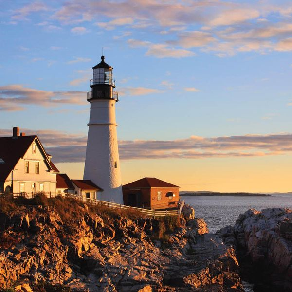 white lighthouse on coast in portland maine