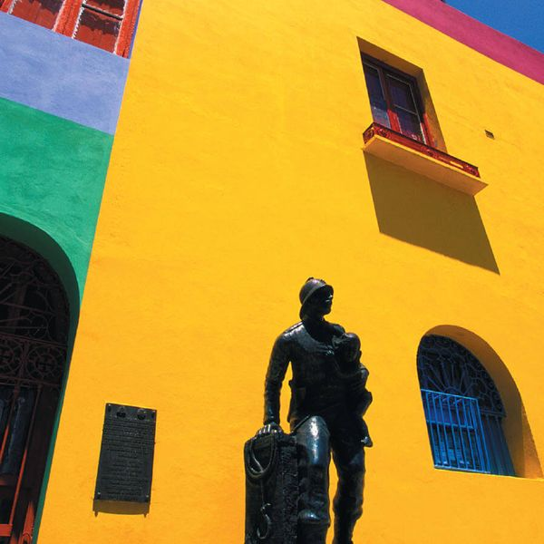 statue in front of colorful building