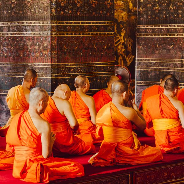 buddhist monks inside a temple in bangkok thailand
