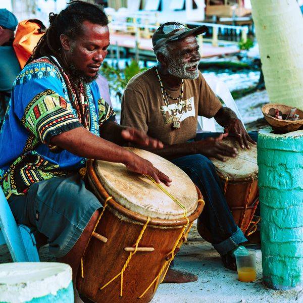 two men leading a garifuna drum lesson at caye caulker