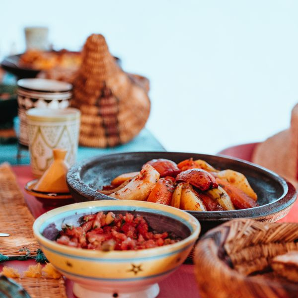a table full of tangine and other moroccan food