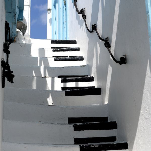 stairs painted like piano keys in mykonos greece