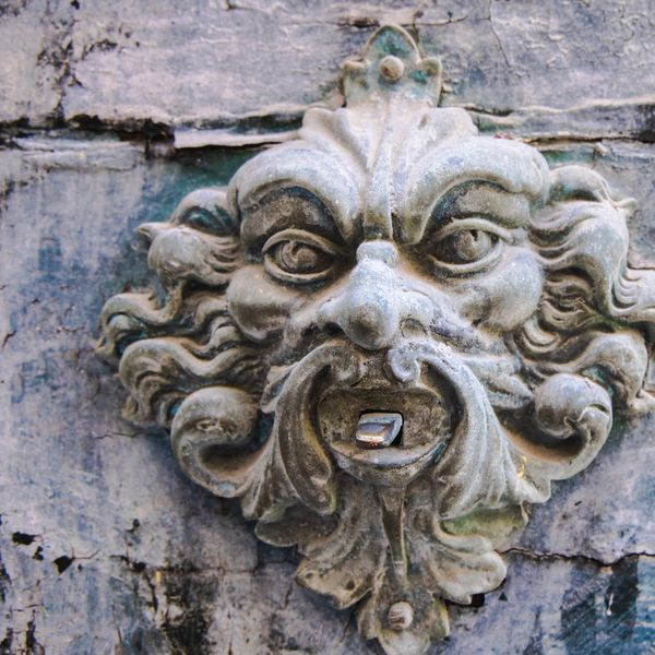 a gothic face carved into stone in florence italy
