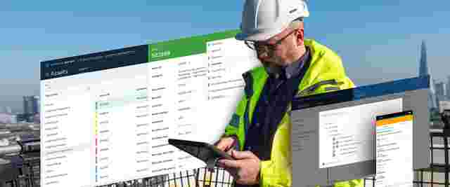 Two construction site managers discuss construction progress and meeting minutes on site.