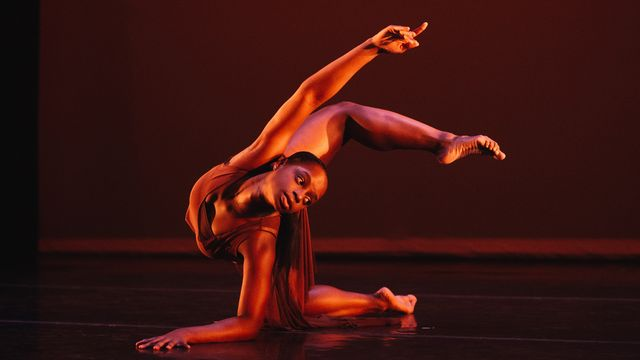 Female student dancing on stage.