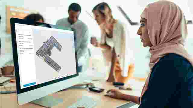 BIM team member viewing issue pins on a 3D model