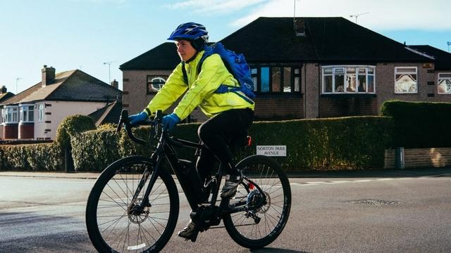 Lucy biking on an eBike