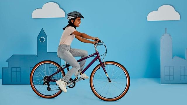 A girl riding the Raleigh POP kids bike