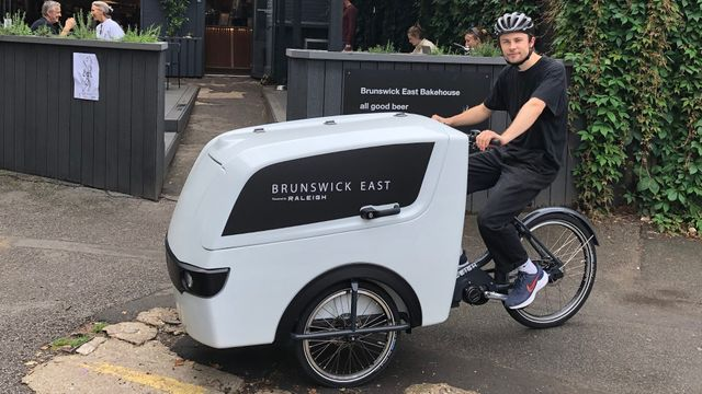 Man riding a Raleigh Pro Cargo Trike for last mile business deliveries