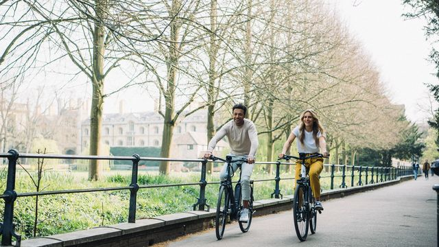 Man and woman biking together