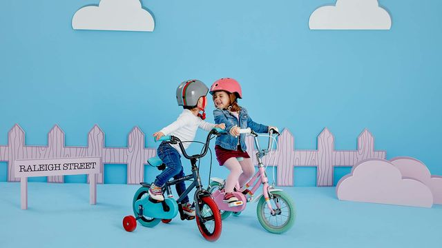 Twins riding the Raleigh POP kid's bikes