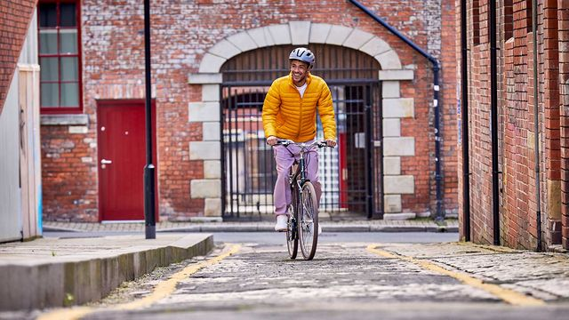 A man riding the Raleigh Pioneer through the city