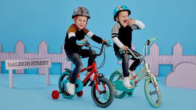 Twins riding Raleigh Pop kids bikes with stabilisers