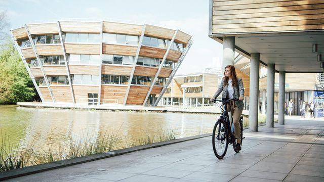 Women riding an electric bicycle