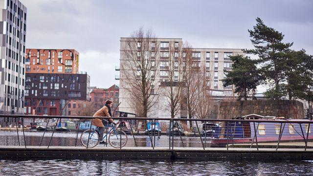 A man biking in the city