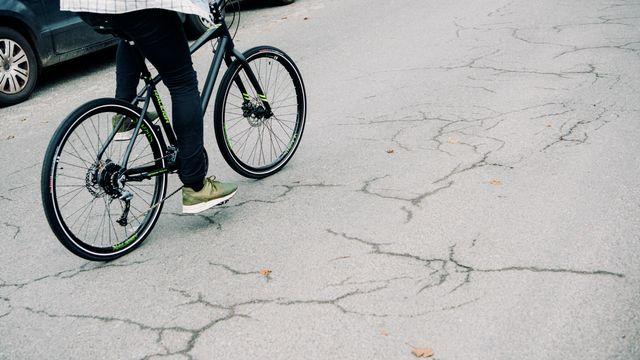 Guy riding a bike uphill