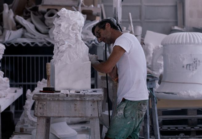 artist Kevin Francis Gray working on one of his marble sculptures in the studio