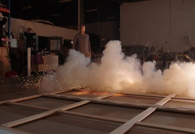 Artist Cai Guo-Qiang igniting one of his installation, studio visit