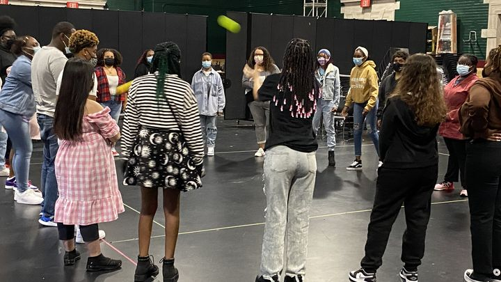 students standing in a circle, introducing themselves during the first day of school