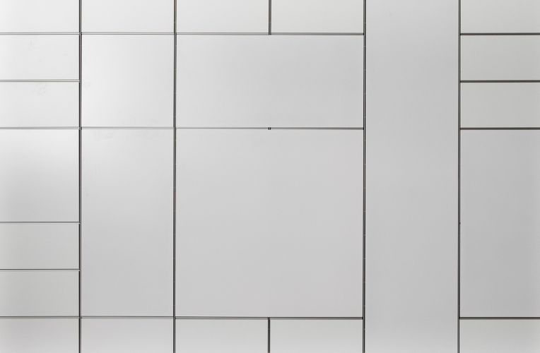 White wall is divided up into rectangular sections.