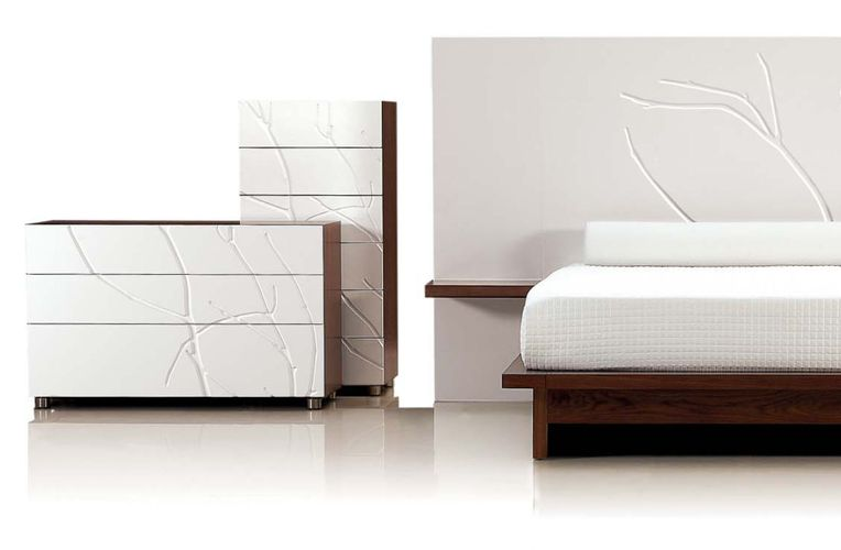 Two varying cabinets and a wall are decorated using branch patterned white Iconic panel.