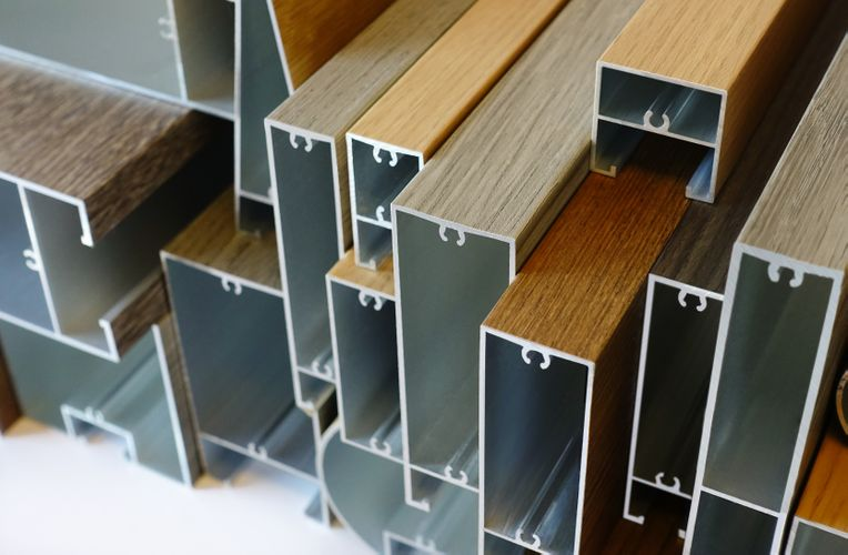 View of the ends of many stacked varying Fortina Panels.