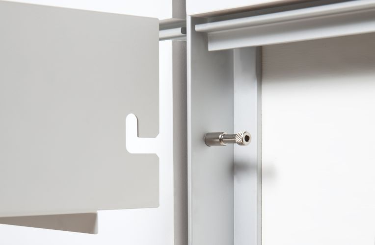 Close-up shot of the edge of a System 1224 shelf sliding into a white structure.