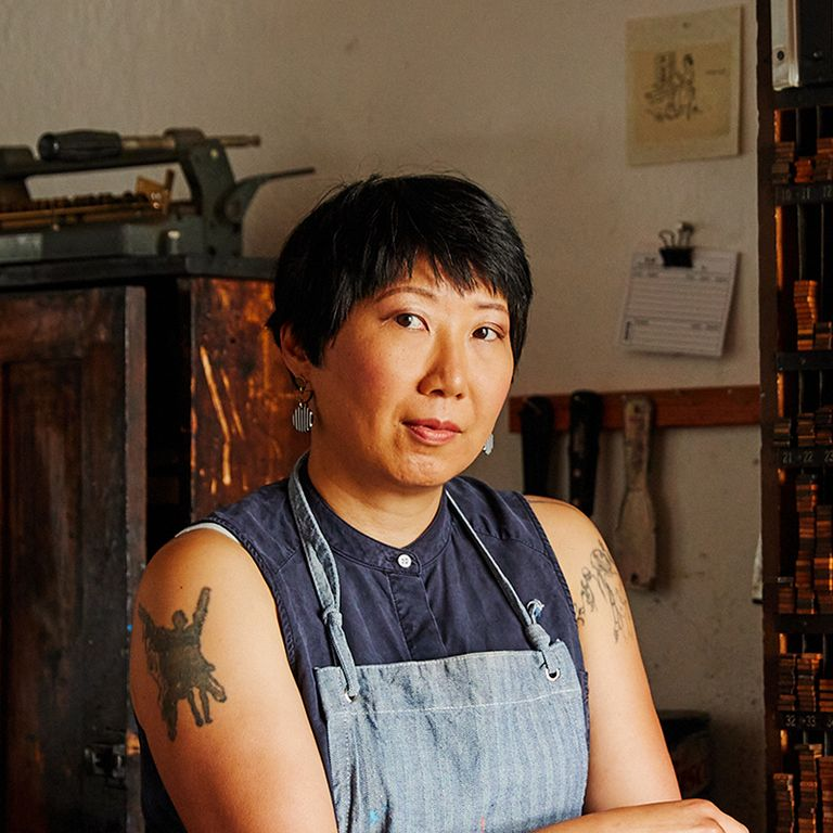 Christine Wong Yap looking towards the camera in her studio