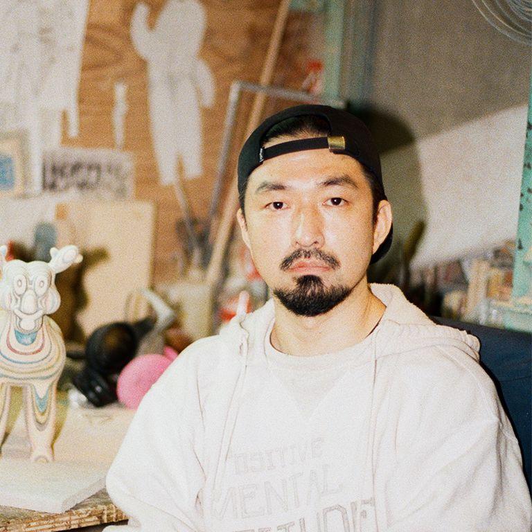 Haroshi looking at the camera wearing a cap