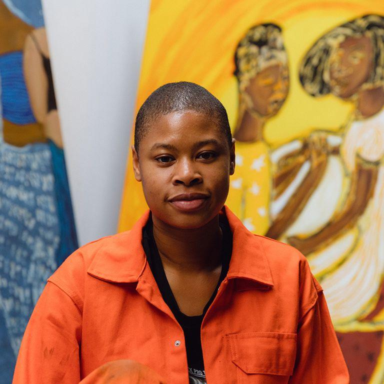 Sola Olulode smiling in her studio