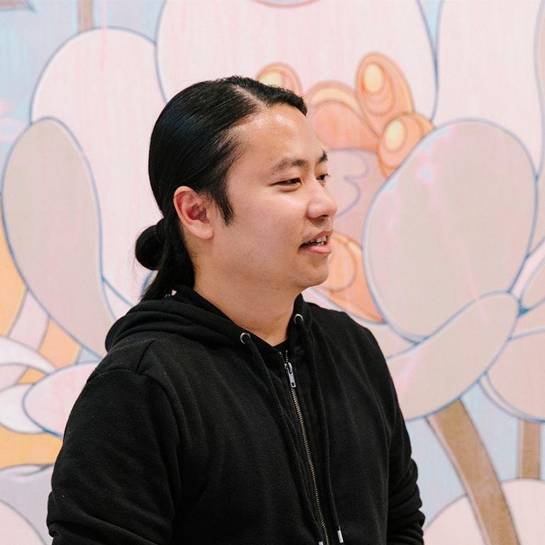 artist in his studio wearing black hoodie