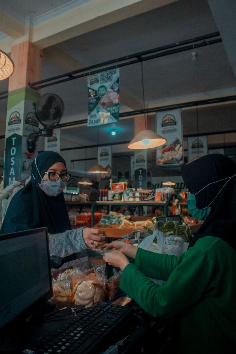 A woman wearing a mask shopping