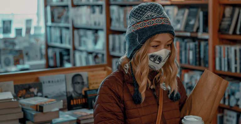 Woman shopping with a mask on her face