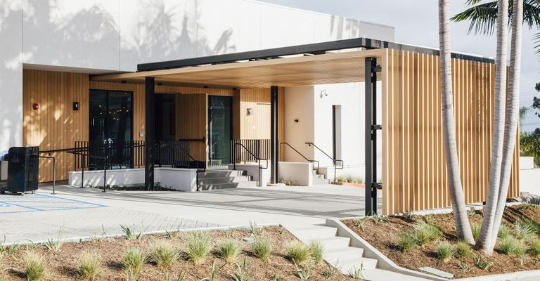 A view of the Griffin Club's outdoor entryway. Wooden Fortina panels are used to decorate the exterior of the building.