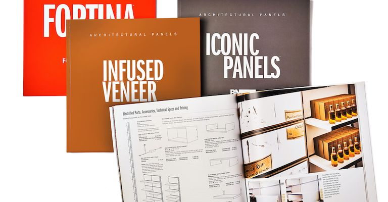 """Various magazines are spread across the image labelled """"Fortina"""", """"Infused Veneer"""", and """"Iconic Panels"""" respectively. The magazine sitting above the rest is open to a spread with architectural drawings and an image of shelves displaying boxes and bottles."""