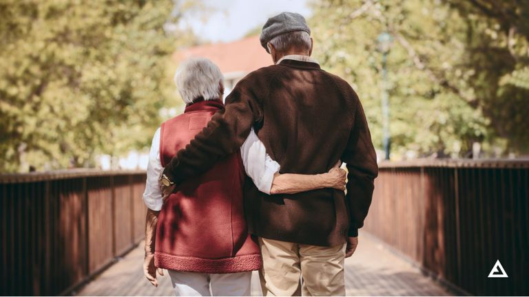 An old couple walking hand in hand