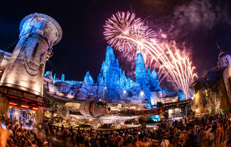 A night sky is lit up by fireworks at Disneyland's Galaxy Edge
