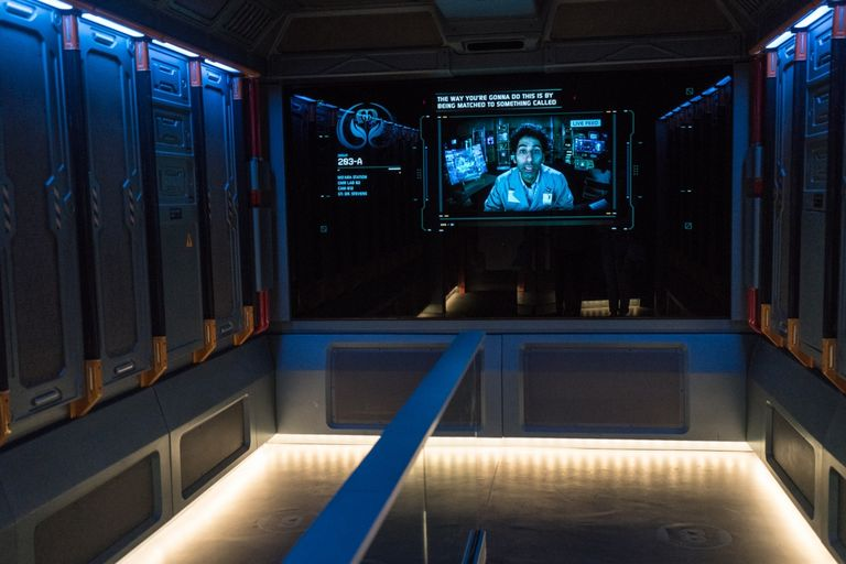 The decontamination room in Flight of Passage, a ride at Disney World, displays a man in a lab coat on the screen.