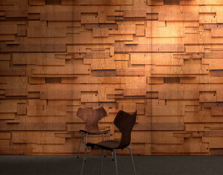 Two wooden chairs are placed in front of a wall decorated with Infused Veneer, making the wall seem as if different wooden blocks of varying shapes are protruding out at different heights.