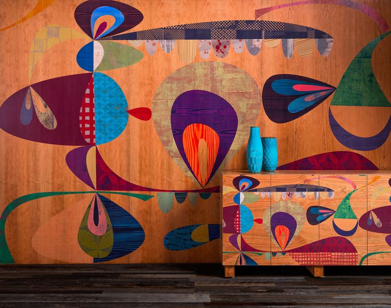 Colorfully painted wall with vivid patterns and imagery.