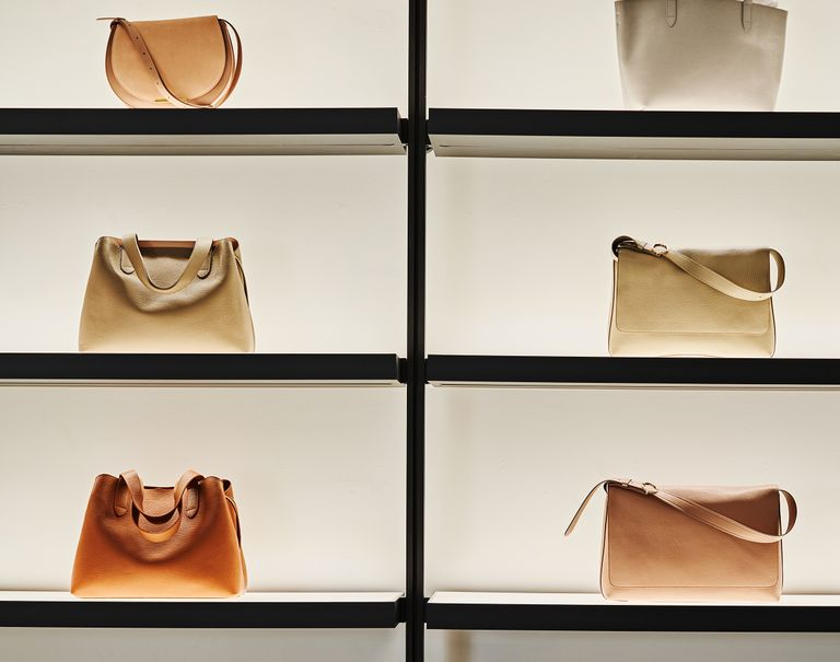 Various bags are lit for display with electrified black Sorbetti shelves.