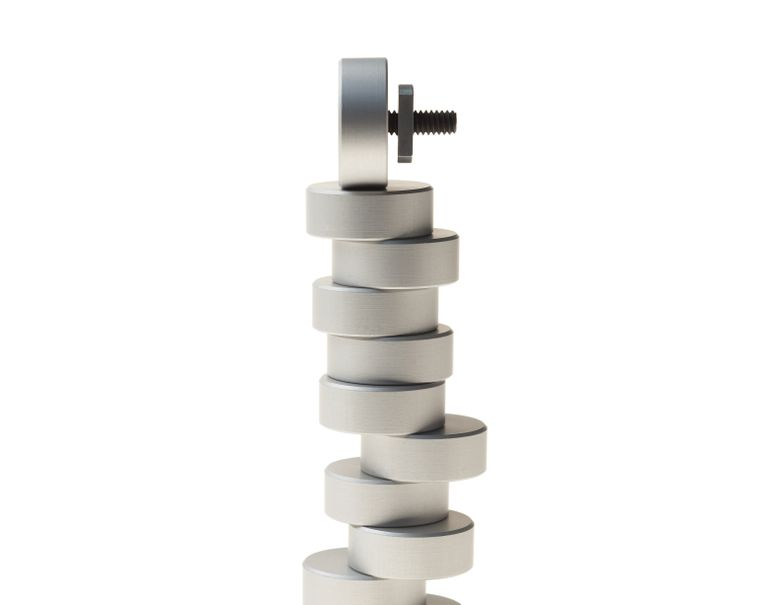 Multiple round puck screws are stacked on top of each other against a white background.