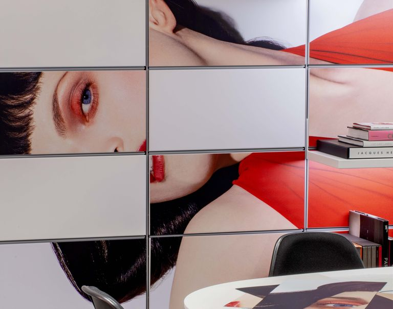 Close-up image of panels along the wall with an image of a woman laying on her side.