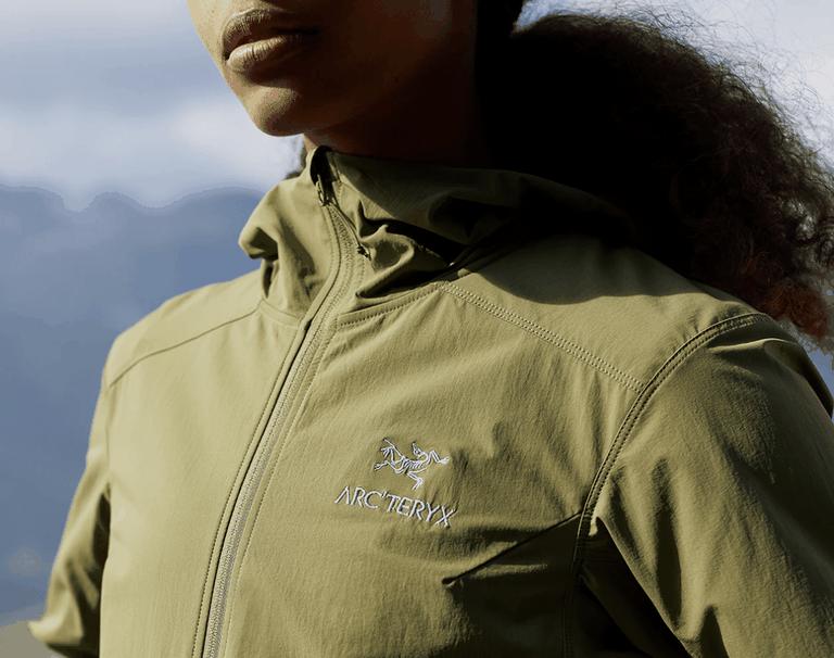 A woman in a green Arcteryx jacket